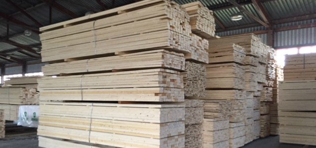 Sawn timber stacked in the warehouse